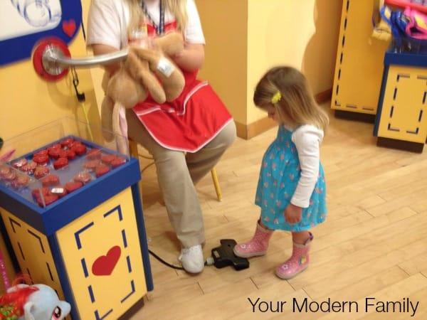 putting pacifier into stuffed animal