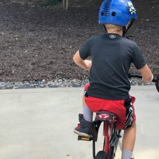 Teaching a child to ride a bike (ditch the training wheels)